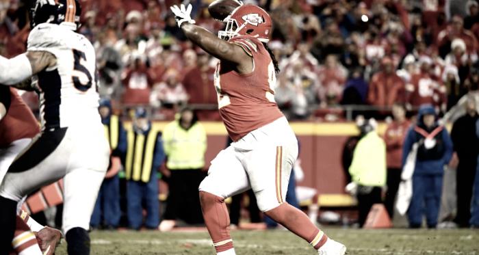 Dontari Poe threw a touchdown last season against the Denver Broncos   Source: Joe Amon - The Denver Post