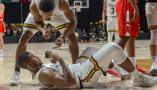 UMBC's Arkel Lamar reacts after RJ Eytle-Rock's and-one play