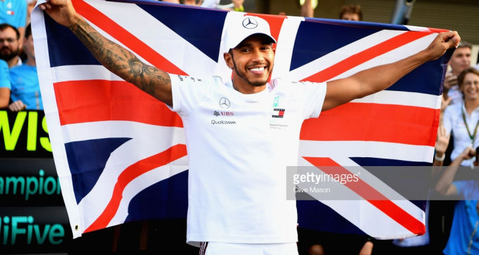 Hamilton celebrating his title success    credit: @getty images