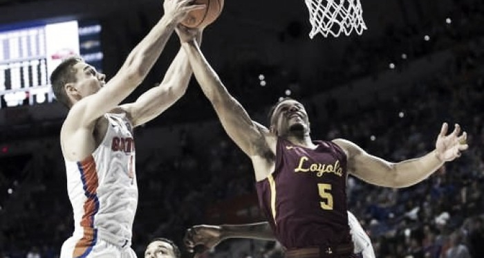 Loyola's Marques Townes and Florida's Egor Kouchelov battle for a rebound during the Ramblers' victory/Photo: Ron Irby/Associated Press