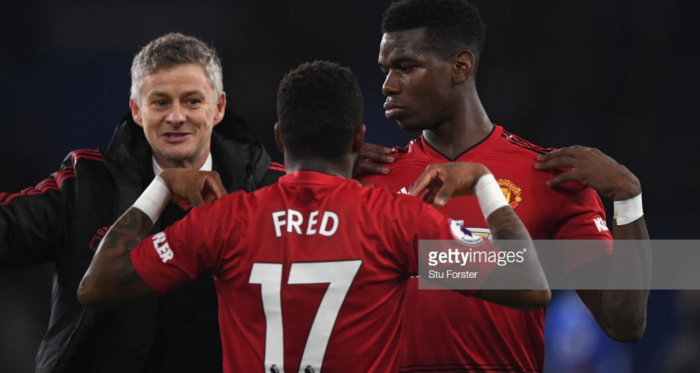 Solskjaer, Pogba, and Fred celebrate after the win at Cardiff City(Photo by Stu Forster/Getty Images)