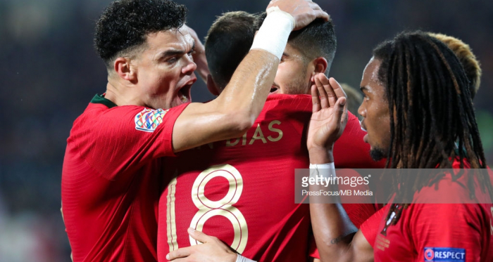 Portugal's Andre Silva celebrates his opening goal in the company of his teammates.