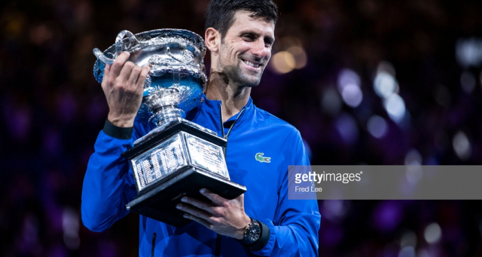 Djokovic holds the championship trophy in Melbourne for a record seventh time/Photo: Fred Lee/ Getty Images