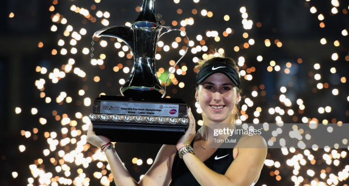 Bencic holds up the championship trophy/Photo: Tom Dulat/Getty Images