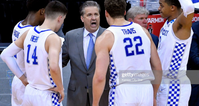 Calipari in the huddle with his team during their Elite 8 game vs Auburn (Kansas City Star/Getty Images)