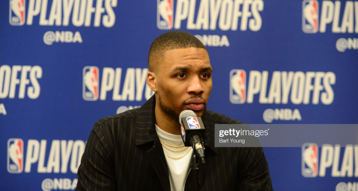 Lillard talking to the media after their Game 1 loss in Denver (Bart Young/Getty Images)