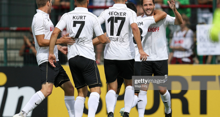 VERL, GERMANY - AUGUST 10: Players of SC Verl celebrate after scoring first goal during the DFB Cup first round match between SC Verl and FC Augsburg at Sportclub Arena on August 10, 2019 in Verl, Germany. (Photo by Maja Hitij/Bongarts/Getty Images)
