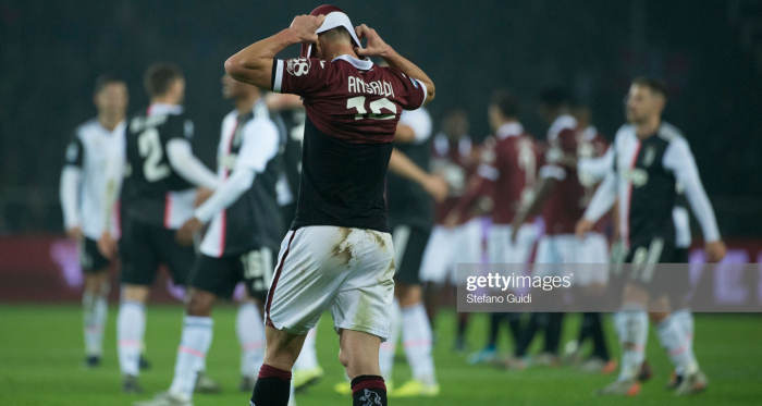 Torino's Cristian Ansaldi covers his face in disappointment after their 1-0 loss to Juventus last weekend (Getty Images/Stefano Guidi)