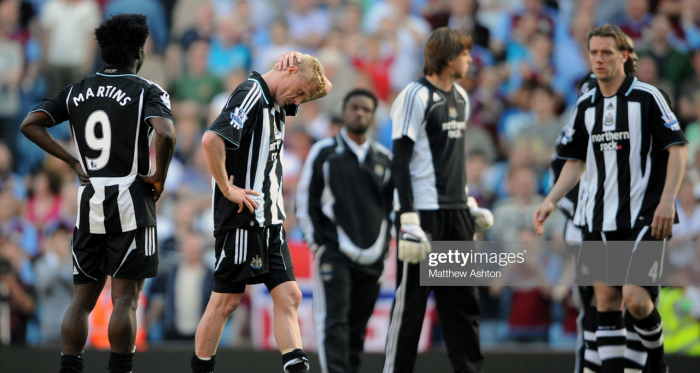 Damien Duff of Newcastle United pictured (C) at the end of the game after he scored an own goal to relegate his team (Photo by AMA/Corbis via Getty Images)