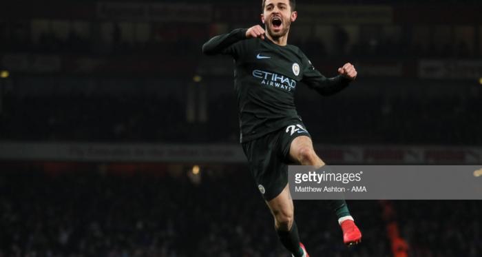 Manchester City's Bernardo Silva celebrates scoring against Arsenal at the Emirates earlier this season (Photo credit: Matthew Ashton, Getty Images)