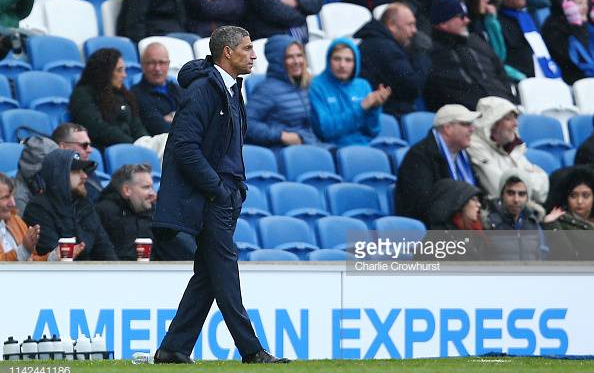 Chris Hughton in the dugout during the 5-0 defeat Bournemouth. Image courtesy of Charlie Crowhurst on Getty Images.