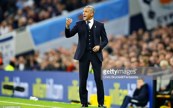 Chris Hughton on the side-line barking orders in the defeat to Tottenham. Image courtesy of  Chris Brunskill from Fantasista on Getty Images.