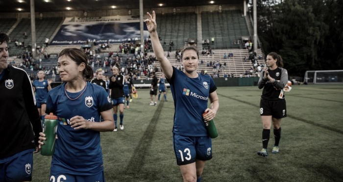 Fletcher (center) after a home game in Seattle. (Source: Seattle Reign FC)