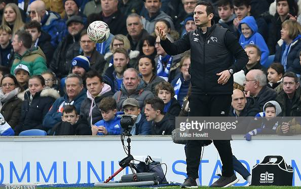 Lampard in the dugout at The Amex picture courtesy of Mike Hewitt on Getty Images.