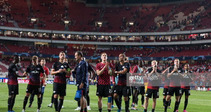 RB Leipzig players saluting their fans following their 2-1 win away at Benfica (GettyImages/TF-Images)