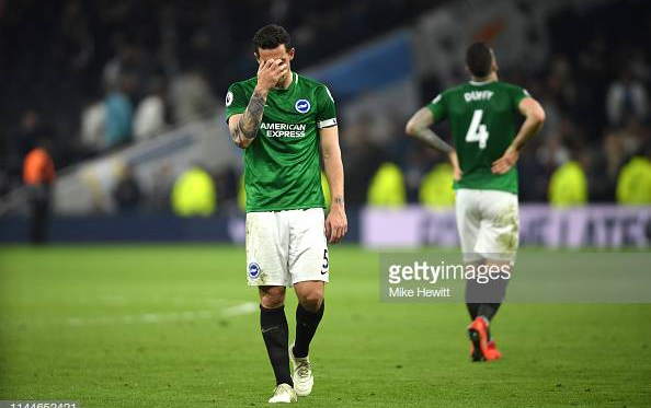 Lewis Dunk (left) and Shane Duffy (right) look demoralised after their late defeat to Tottenham. Image courtesy of Mike Hewitt on Getty Images.