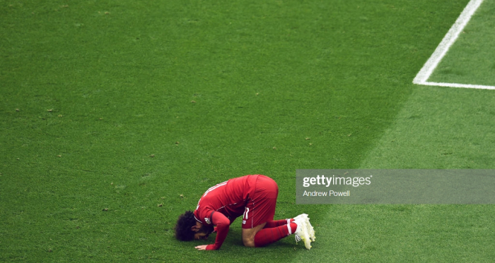 Mohamed Salah of Liverpool scores the first goal and celebrates during the Premier League match between Liverpool FC and Chelsea FC at Anfield on April 14, 2019 in Liverpool, United Kingdom. (Photo by Andrew Powell/Liverpool FC via Getty Images)