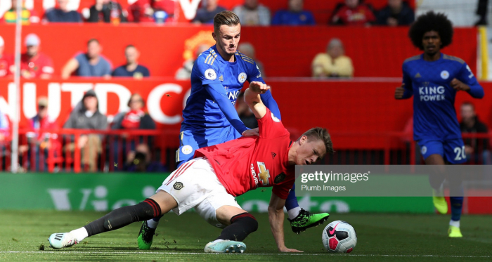 MANCHESTER, ENGLAND - SEPTEMBER 14: James Maddison of Leicester City in action with Scott McTominay of Manchester United during the Premier League match between Manchester United and Leicester City at Old Trafford on September 14, 2019 in Manchester, United Kingdom. (Photo by Plumb Images/Leicester City FC via Getty Images)
