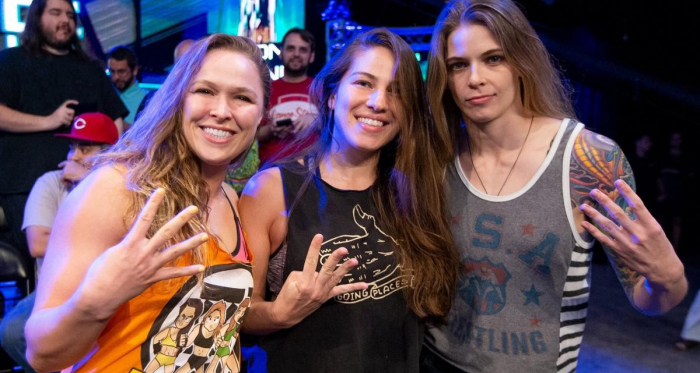 Ronda Rousey (Left) poses with Marina Shafir (Center) and Jessamyn Duke (Right) in support of Shayna Baszler at the Mae Young Classic. | Photo Credit: WWE.com