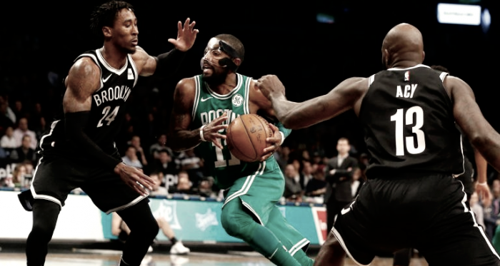 Boston Celtics' Kyrie Irving drives past Brooklyn Nets' Rondae Hollis-Jefferson (24) and Quincy Acy (13). Photo: Jim McIsaac