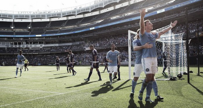 Frederic Brillant (right, in blue) celebrates with teammates after scoring the game's opening goal in New York City FC's 2-2 draw with Orlando City SC on Sunday, May 29. (Photo credit: Tim Clayton/Corbis Images)