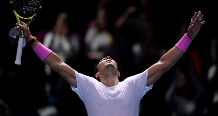 Nadal exults as he celebrates his epic comeback against Medvedev/Photo: Reuters