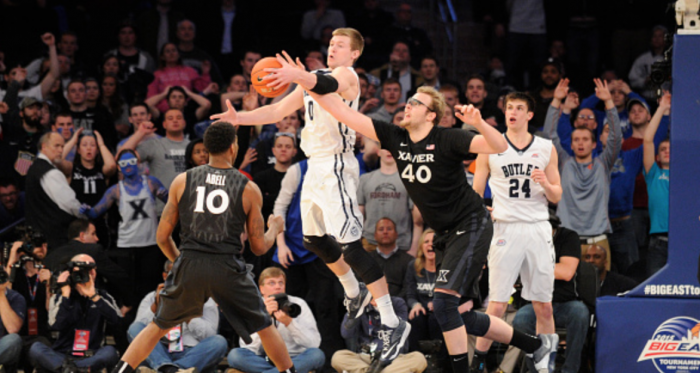 Matt Stainbrook #40 of the Xavier Musketeers and Austin Etherington #0 of the Butler Bulldogs during a quarterfinal game of the Big East basketball tournament at Madison Square Garden on March 12, 2015 in New York City. The Musketeers won 67-61.