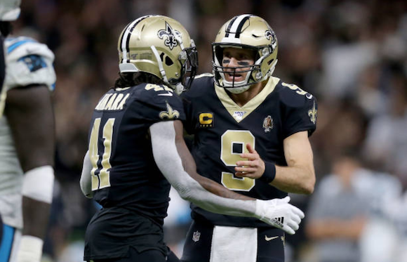 Drew Brees and Alvin Kamara in action against the Panthers (Photo: Jonathan Bachman)