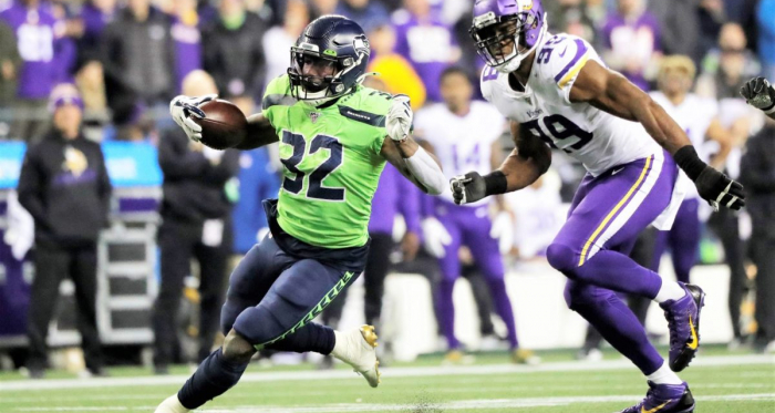 Chris Carson rushes the ball against the Minnesota Vikings. Carson was a major factor in the Seahawks gameplan, and ultimately helped them to a victory and pull ahead in the NFC West. (Ted S Warren / AP Photo)