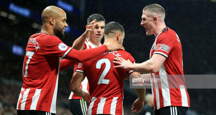 <div>LONDON, ENGLAND - NOVEMBER 09: George Baldock of Sheffield United celebrates with teammates after scoring his team's first goal during the Premier League match between Tottenham Hotspur and Sheffield United at Tottenham Hotspur Stadium on November 09, 2019 in London, United Kingdom. (Photo by Stephen Pond/Getty Images)</div>