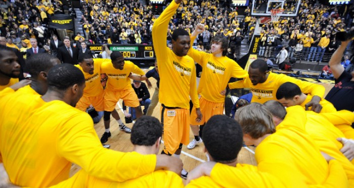 The team huddles up before a game at Charles Koch Arena. Photo courtesy of Peter G, Aiken/USA TODAY Sports.