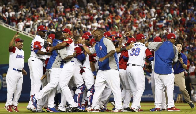"<span style=""font-style: normal; caret-color: rgb(136, 136, 136); color: rgb(136, 136, 136); font-family: Helvetica, Arial; text-align: left;"">Dominican Republic celebrates after a game against the USA during the 2017 World Baseball Classic at Marlins Park. 