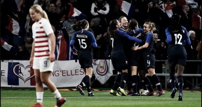 Midfielder Lindsey Horan (left) walks away as France celebrates a goal. | Associated Press