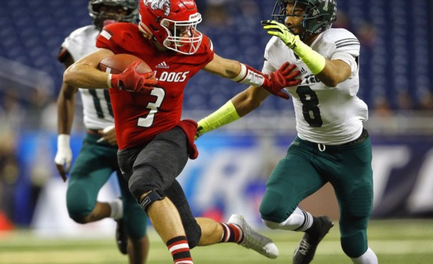 Romeo's Lucas Schimon (3) tries to escape Detroit Cass Tech's Demetric Vance (8) before running in for a touchdown in the first quarter of their 2015 MHSAA Division 1 state final game at Ford Field.(Mike Mulholland   MLive.com)