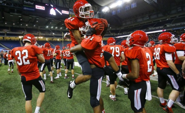 Orchard Lake St. Mary's Josh Mosley (41) celebrates with Chelsea's Joseph Wise (31) in the closing seconds of their 2015 MHSAA Division 5 state final game at Ford Field.(Mike Mulholland | MLive.com)