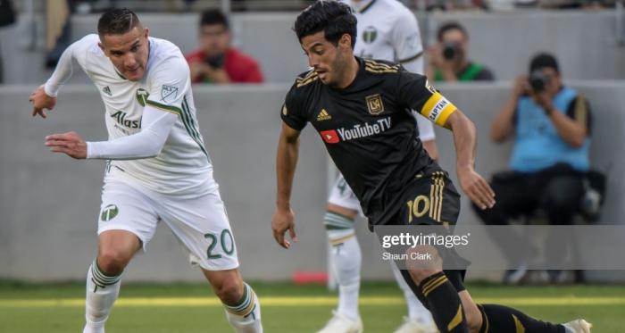 Carlos Vela takes on Portland's David Guzman in LAFC's 4-1 victory: (Getty Images - Shaun Clark)