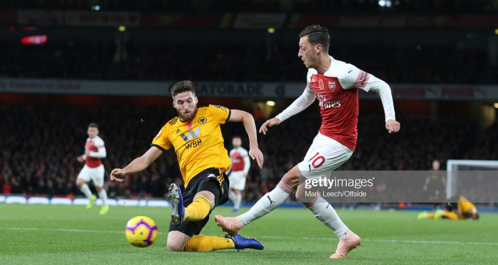 Matt Doherty and Mesut Ozil battle out in the two sides' last meeting in December