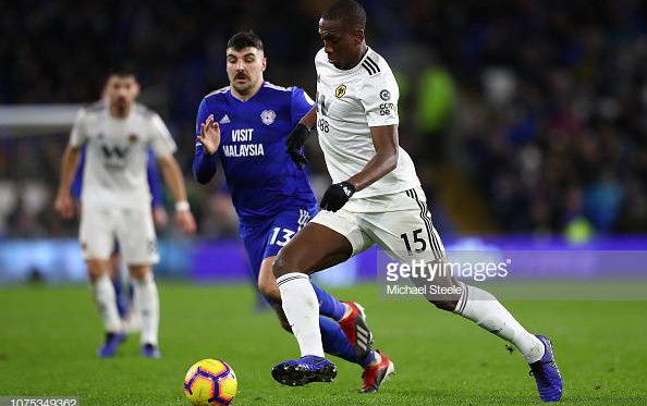 Willie Boly of Wolverhampton Wanderers tracked by Callum Paterson of Cardiff City during the Premier League match between Cardiff City and Wolverhampton Wanderers at Cardiff City Stadium on November 30, 2018 in Cardiff, United Kingdom. (Photo by Michael Steele/Getty Images)
