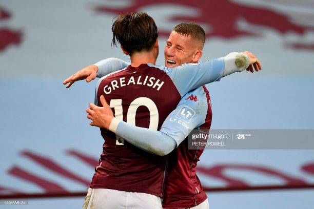 Aston Villa's English midfielder Jack Grealish (L) celebrates with Aston Villa's English midfielder Ross Barkley (R) after scoring their sixth goal during the English Premier League football match between Aston Villa and Liverpool at Villa Park in Birmingham, central England on October 4, 2020