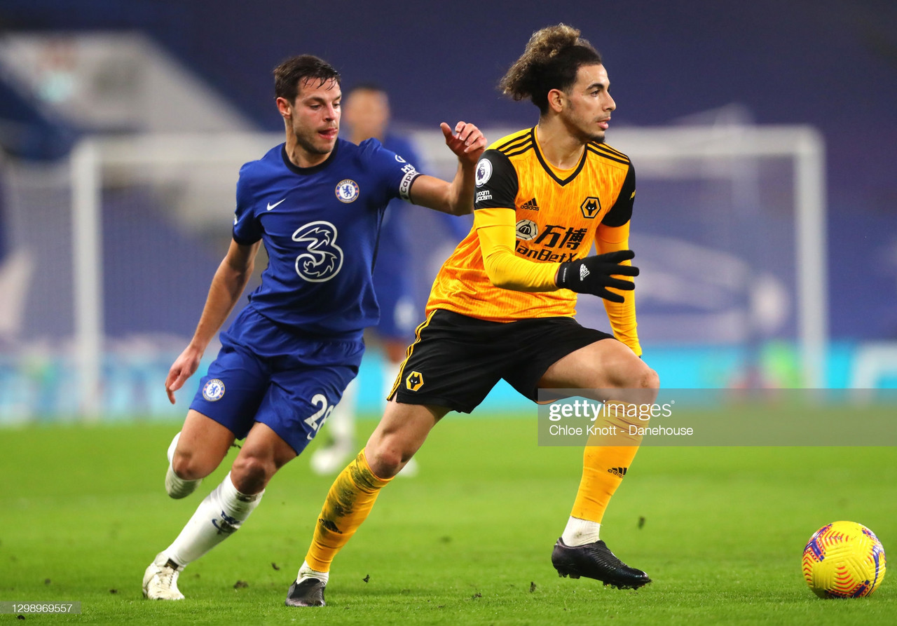 LONDON, ENGLAND - JANUARY 27: Rayan Ait Nouri of Wolverhampton Wanderers and Cesar Azpilicueta of Chelsea FC in action during the Premier League match between Chelsea and Wolverhampton Wanderers at Stamford Bridge on January 27, 2021 in London, England. Sporting stadiums around the UK remain under strict restrictions due to the Coronavirus Pandemic as Government social distancing laws prohibit fans inside venues resulting in games being played behind closed doors. (Photo by Chloe Knott - Danehouse/Getty Images)