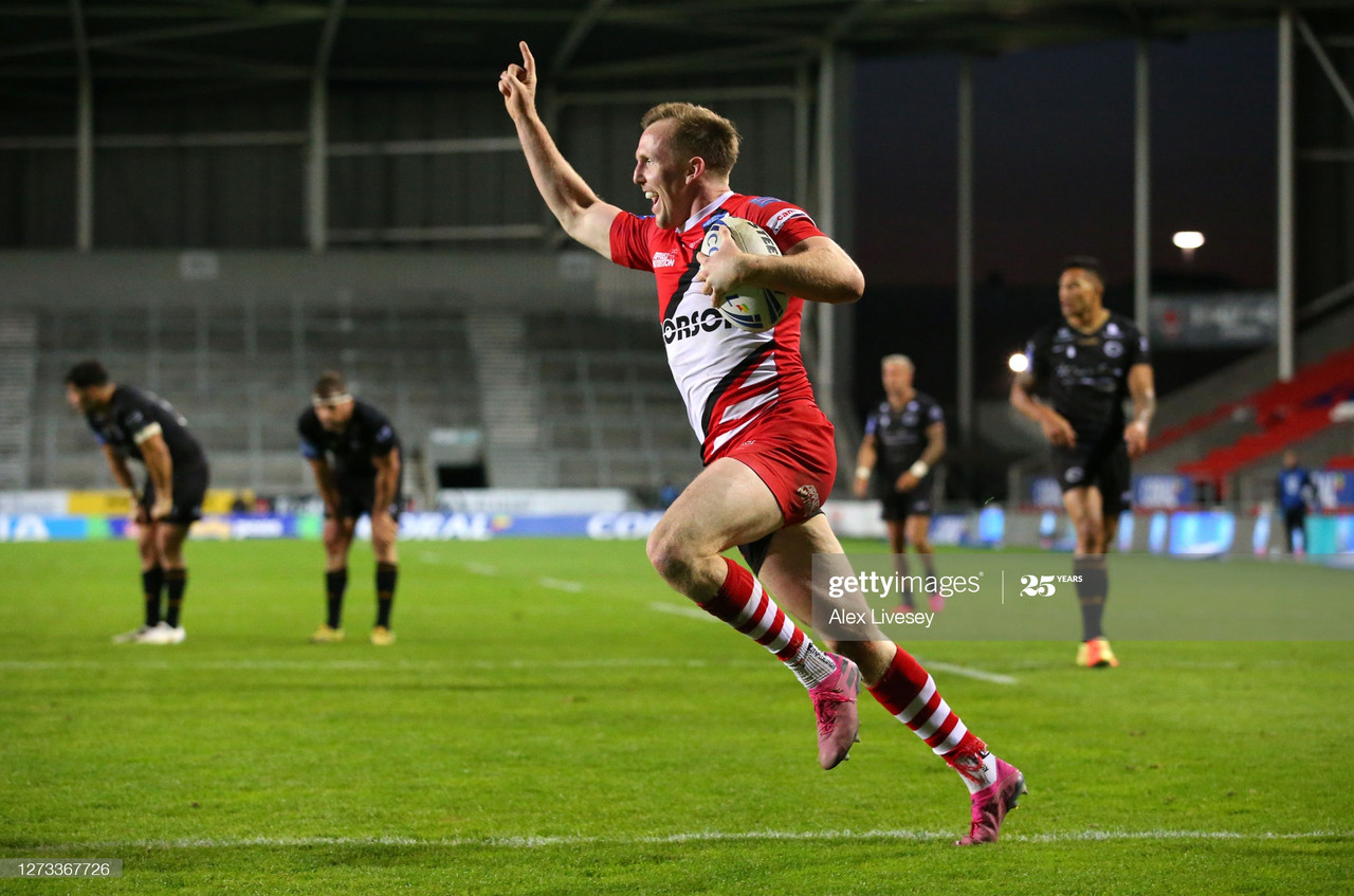 ST HELENS, ENGLAND - SEPTEMBER 18: Dan Sargison of Salford Red Devils celebrates as he crosses the line to score a golden points try in extra time for victory over Catalans Dragons during the Coral Challenge Cup Quarter Final match between Catalans Dragons and Salford Red Devils at Totally Wicked Stadium on September 18, 2020 in St Helens, England. (Photo by Alex Livesey/Getty Images)