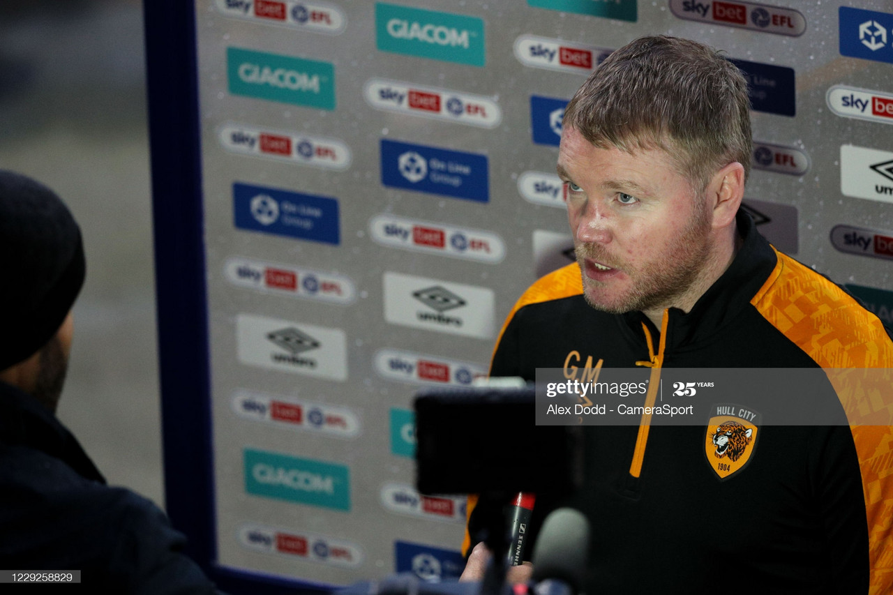 <div>Above: Grant McCann speaks to the media after his side's defeat at the hands of Peterborough United&nbsp;</div>(Photo by Alex Dodd - CameraSport via Getty Images)
