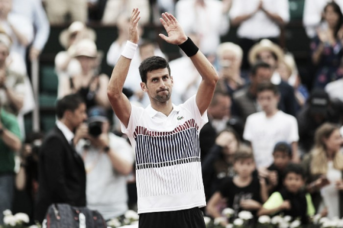 French Open: Novak Djokovic survives an almighty scare to continue his title defense into the second week