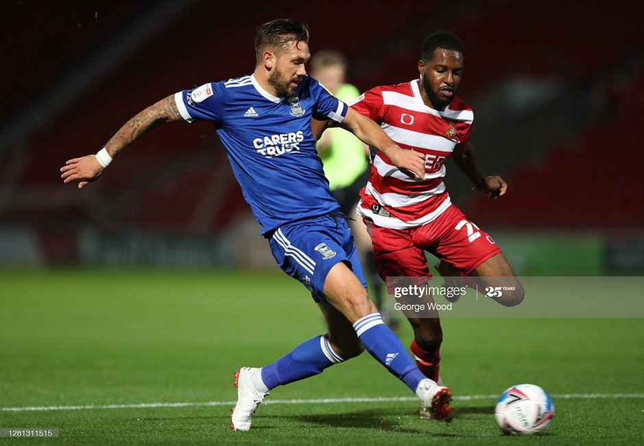 Luke Chambers crosses for Ipswich Town's opener, but it would only get worse for his team as Doncaster Rovers earned a decisive win. Photo: George Wood/Getty Images.