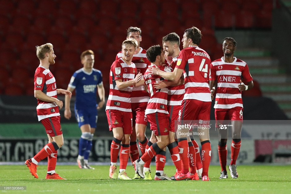 Doncaster Rovers' players celebrate the first of Ben Whiteman's two goals in their impressive win over Ipswich Town. Photo: George Wood/Getty Images.