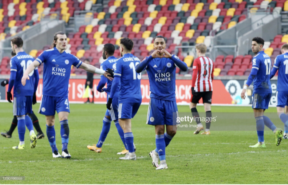 BRENTFORD, ENGLAND - JANUARY 24: Youri Tielemans of Leicester City celebrates after scoring from the penalty spot to make it 1-2 during The Emirates FA Cup Fourth Round match between Brentford and Leicester City at Brentford Community Stadium on January 24, 2021 in Brentford, England. Sporting stadiums around the UK remain under strict restrictions due to the Coronavirus Pandemic as Government social distancing laws prohibit fans inside venues resulting in games being played behind closed doors. (Photo by Plumb Images/Leicester City FC via Getty Images)