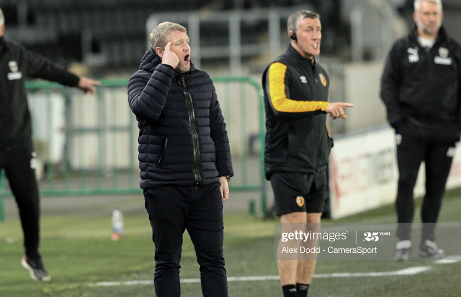 <div>Above: Grant McCann and his assistant Cliff Burn look on at the KCOM Stadium&nbsp;</div>(Photo by Alex Dodd - CameraSport via Getty Images)