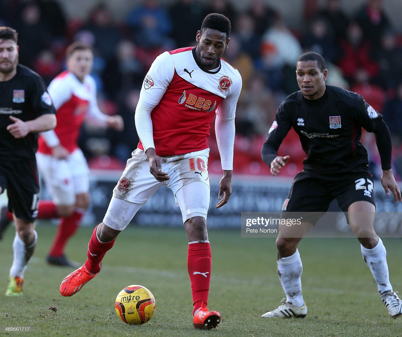 FLEETWOOD, ENGLAND - FEBRUARY 15: Jamille Matt of Fleetwood Town looks to play the ball watched by Mathias Kouo-Doumbe of Northampton Town during the Sky Bet League Two match between Fleetwood Town and Northampton Town at Highbury Stadium on February 15, 2014 in Fleetwood, England. (Photo by Pete Norton/Getty Images)