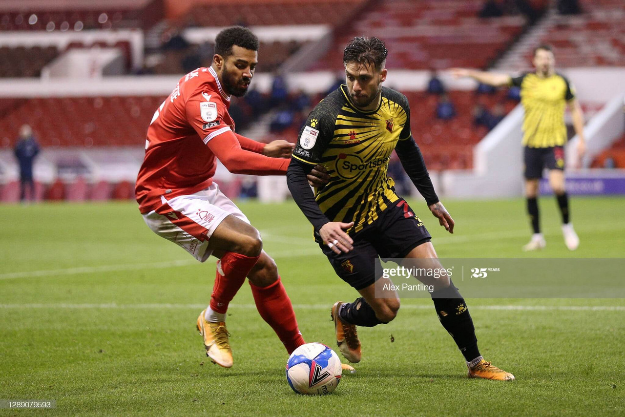 NOTTINGHAM, ENGLAND - DECEMBER 02: Kiko Femania of Watford looks to break past Cyrus Christie of Nottingham Forest during the Sky Bet Championship match between Nottingham Forest and Stoke City at City Ground on December 02, 2020 in Nottingham, England. The match will be played without fans, behind closed doors as a Covid-19 precaution. (Photo by Alex Pantling/Getty Images)