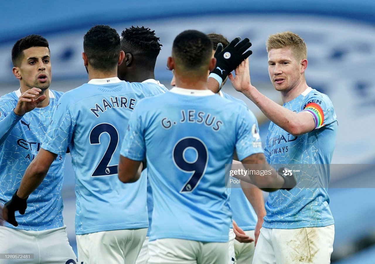 <div>MANCHESTER, ENGLAND - DECEMBER 05: Kevin De Bruyne of Manchester City celebrates with teammate Riyad Mahrez and Gabriel Jesus after scoring his team's second goal during the Premier League match between Manchester City and Fulham at Etihad Stadium on December 05, 2020 in Manchester, England. The match will be played without fans, behind closed doors as a Covid-19 precaution. (Photo by Dave Thompson - Pool/Getty Images)</div><div><br></div>